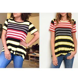 Black + red multicolor striped jersey tunic top
